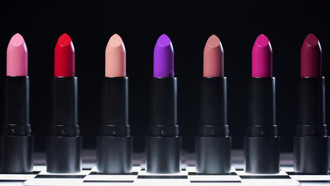 Line of lipsticks for woman makeup opens one by one by itself, beauty goods for Live Action