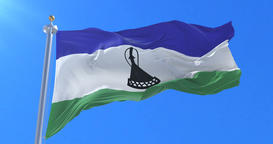 Lesotho flag waving at wind with blue sky in slow, loop Animation