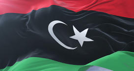 Libya flag waving at wind with blue sky in slow, loop Animation