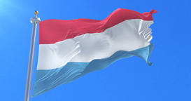 Flag of Luxembourg waving at wind with blue sky in slow, loop Animation