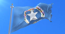 Flag of the Northern Mariana Islands waving at wind with blue sky in slow, loop Animation