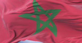 Morocco flag waving at wind in slow in blue sky, loop Animation