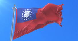 Flag of Myanmar or Union of Burma waving at wind in slow in blue sky, loop Animation