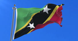 Flag of Saint Kitts and Nevis waving at wind in slow with blue sky, loop Animation