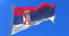 Flag of Serbia waving at wind in slow with blue sky, loop Animation
