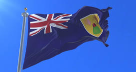 Flag of the Turks and Caicos Islands waving at wind with blue sky, loop Animation