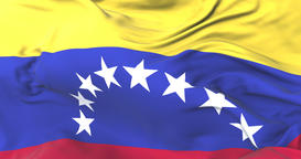 Flag of Venezuela waving at wind in slow with blue sky, loop Animation
