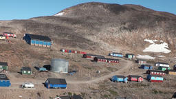 Houses in the mountains of Greenland in the Arctic Ocean Footage