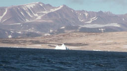 Mountains on shore in mountains on shore of Greenland in Arctic Ocean Footage