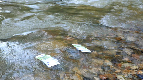 Money bills floating on the river Footage