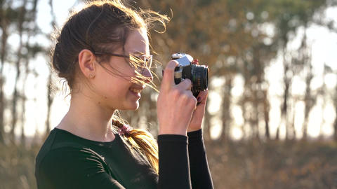 Beautiful girl takes pictures of her beloved man on a film camera Footage