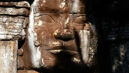 Face of a god or goddess sculpted in stone in a Hindu or buddhist temple 영상물