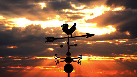 Weathervane cockerel against red sunset Footage