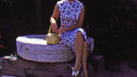 1962: Mature women taking break touring Santa Ines Mission Footage