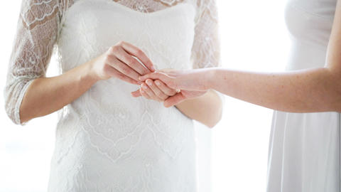 close up of lesbian couple hands with wedding ring ビデオ