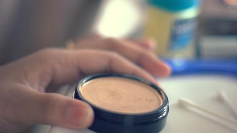 Using makeup powder and brush Footage