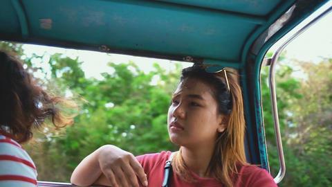 Girl sitting in open air van slowmotion Footage