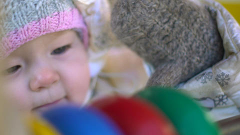 Baby girl playing with abacus closeup portrait Footage