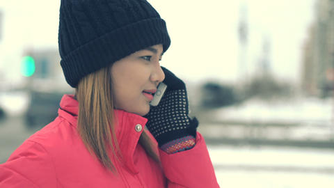 Woman talking on smart phone in winter city Footage