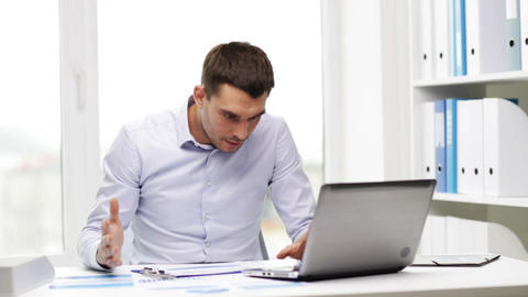 busy businessman with laptop and papers in office Footage