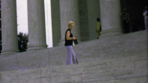 1963: Women climbing stairs roman collumnes style public building Footage