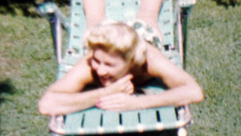 1962: Blonde caucasian women sunbathe outdoor bright summer Footage