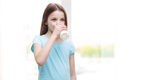happy smiling little girl drinking milk at home Footage