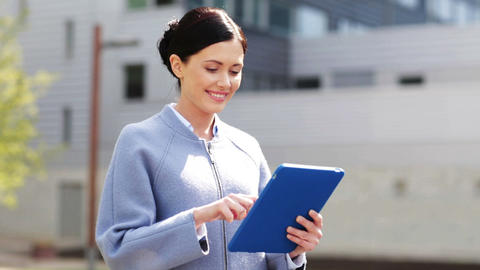 smiling business woman with tablet pc in city Footage