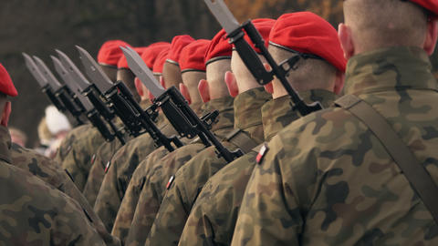 soldiers with machine guns and bayonet knives stand in a row, in red berets Footage