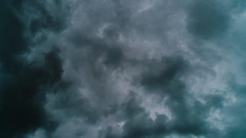 A very dark rainy clouds move rapidly across the sky time lapse Footage