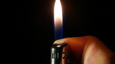 Cigarette lighter on the hand Footage