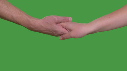 Woman puting palm upper man's hand. Tender couple shaking hands, chroma key Live Action