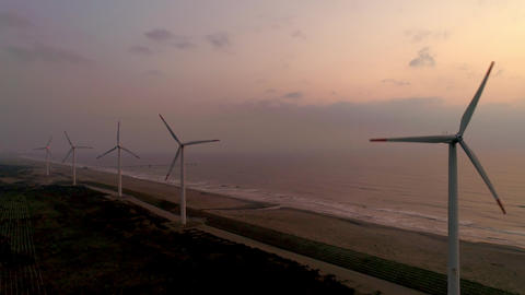 Aerial - Morning glow's wind power plant and sea ビデオ