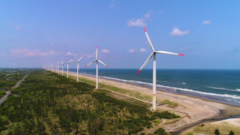 Aerial - Sunny day's wind power plant and sea ビデオ