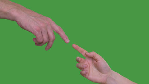 Human hands touching with fingers as Michelangelo hands on green background Footage