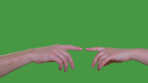 Two people hands touching with index fingers isolated on green background Alpha Live Action