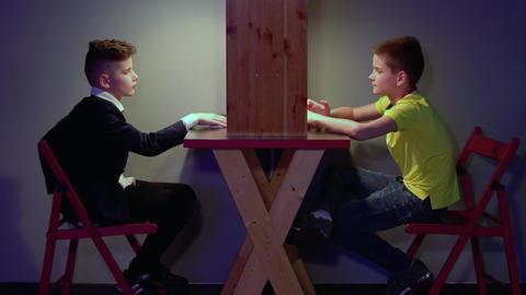 Two boys makes fun in front of each other Footage
