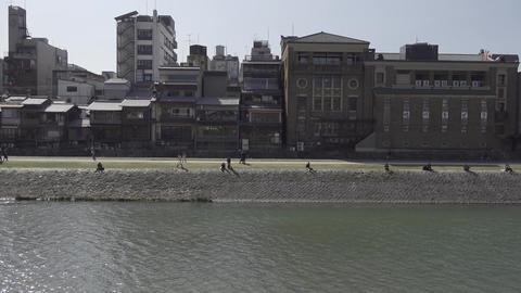 People walking in the Kamogawa riverside Kyoto Japan GIF