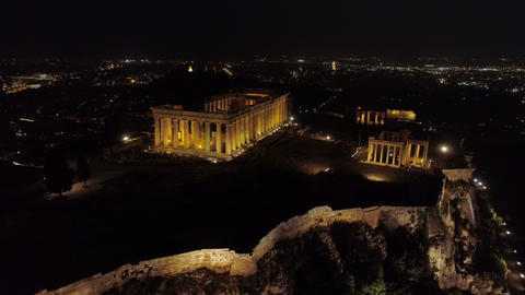 Aerial night video of iconic ancient Acropolis hill and the Parthenon at night, Footage
