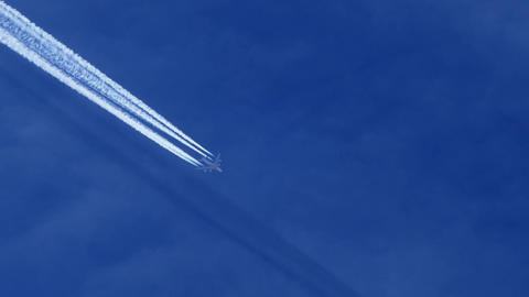 fumes from aircraft and engines in blue sky Live Action