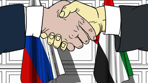 Businessmen or politicians shake hands against flags of Russia and UAE. Official Footage