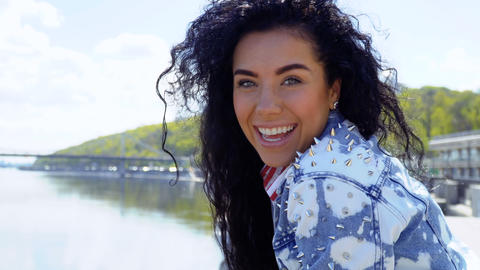 Happy beautiful brunette in jeans jacket with thorns Footage