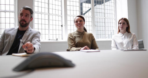 Colleagues on a conference call in a business meeting Footage