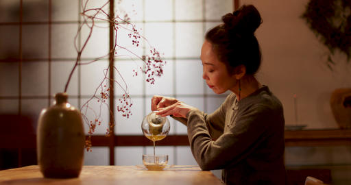 Japanese Female pouring green tea in traditional house, Kyoto, Japan GIF