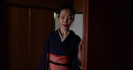 Japan, Kyoto, woman in kimono walking in traditional home, Japan, Kyoto Live Action