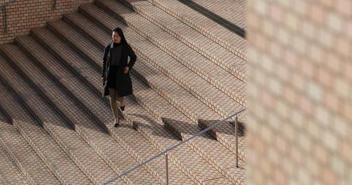 Japanese woman walking down steps in business district Tokyo, Japan Footage