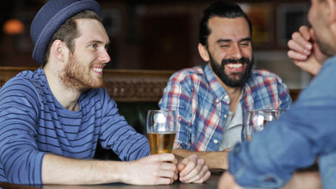 happy male friends drinking beer at bar or pub Footage
