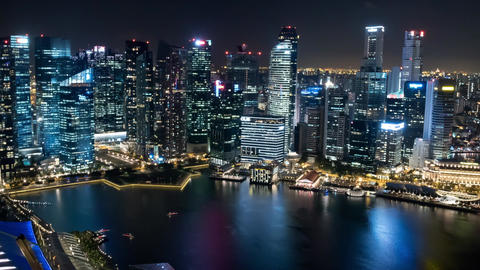 Singapore Timelapse Skyline at Night with Traffic and Skyscrapers Pan Footage