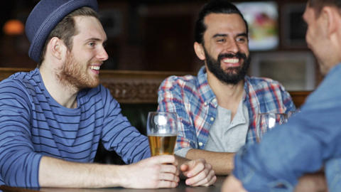 happy male friends drinking beer at bar or pub 影片素材