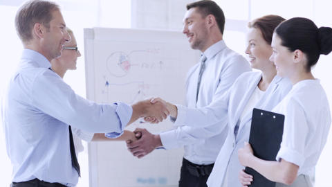 business people shaking their hands Footage